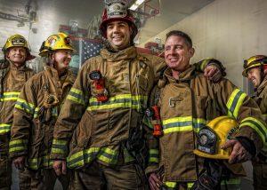 5 firemen smiling